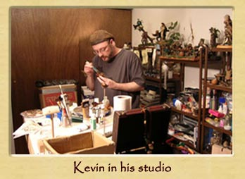 Kevin painting one of his characters